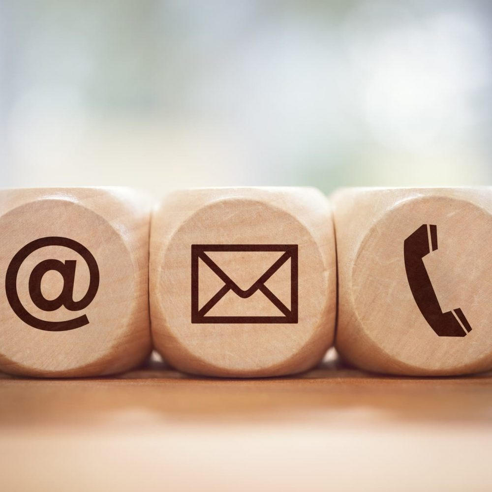 Contact us concept with wood block and symbols