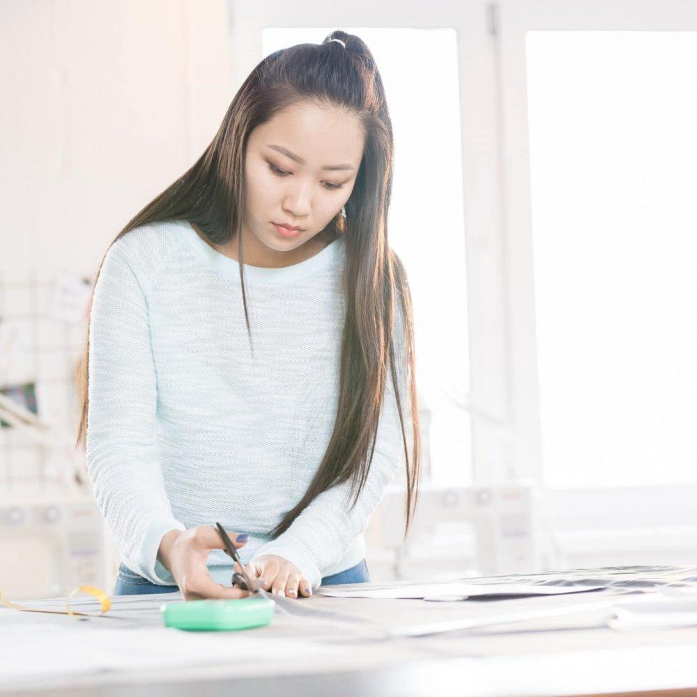 Female Asian Tailor in Atelier