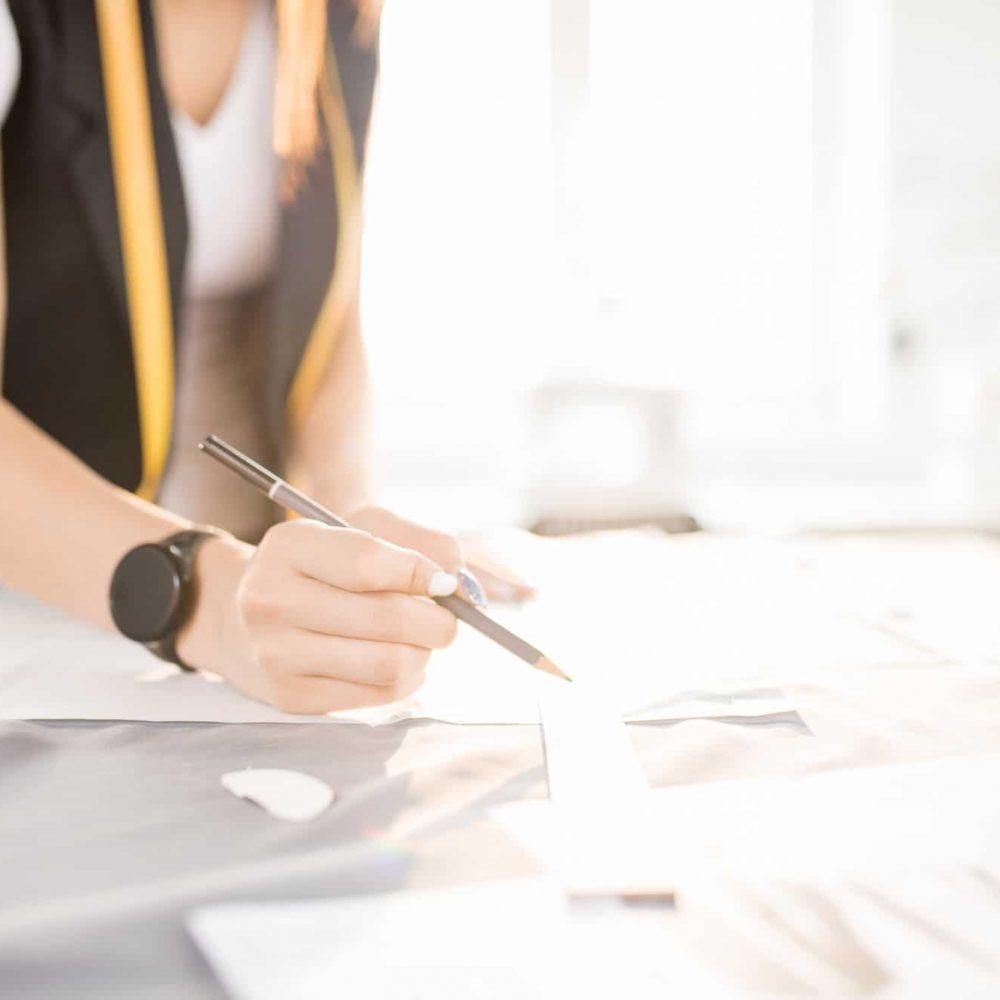 Modern Female Tailor Making Dress