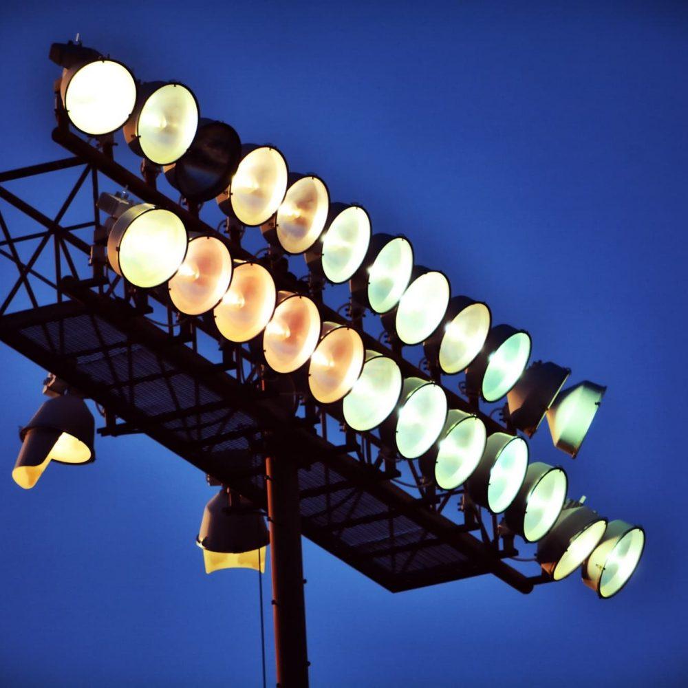 Stadium Lights Warming Up at Night